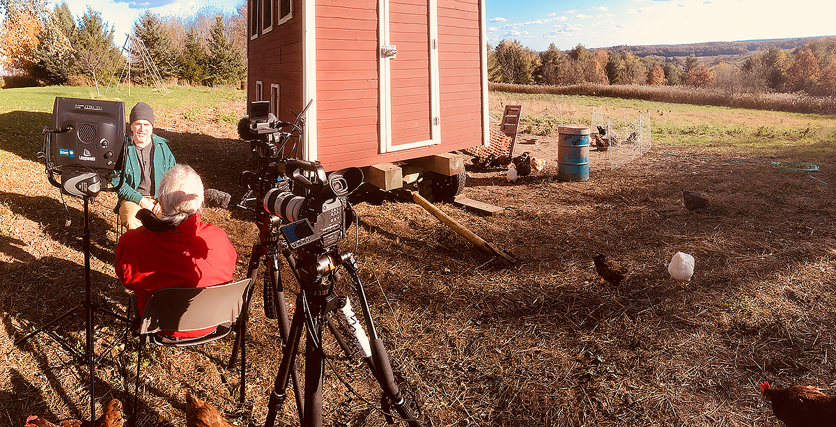 Michael Perry tells stories outside of his chicken coop on a sunny fall day