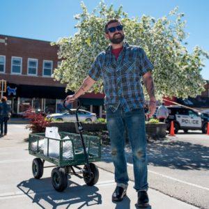 Luke Zahm pulls a wagon filled with produce through Viroquas downtown