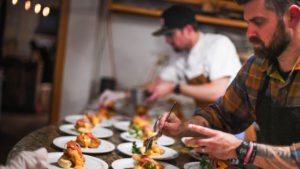 Luke and his staff prepare dozens of plates for a dinner