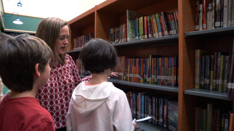 Instructor from Elmbrook School District in the library with students