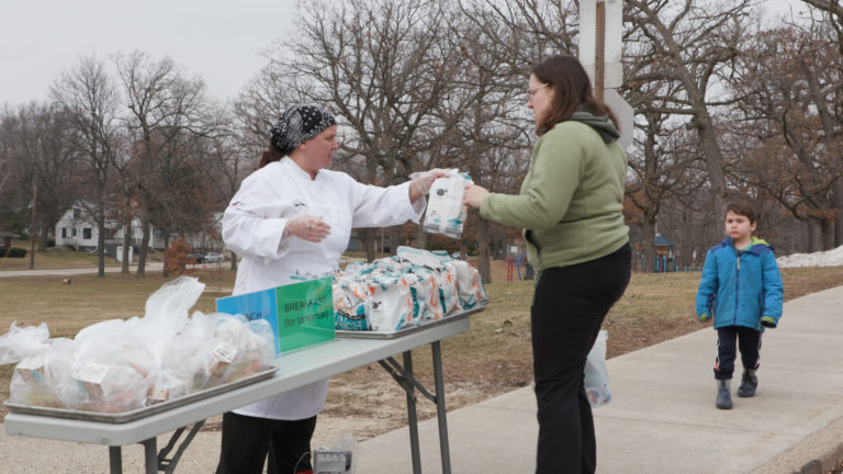 District parent receives school lunch on March 16, 2020 in Madison while schools are shut down due to novel coronavirus.