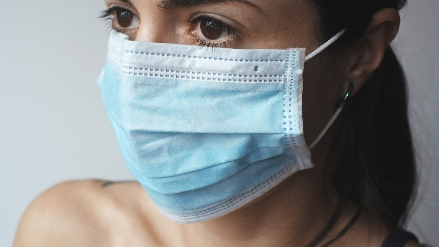 woman in protective hospital mask
