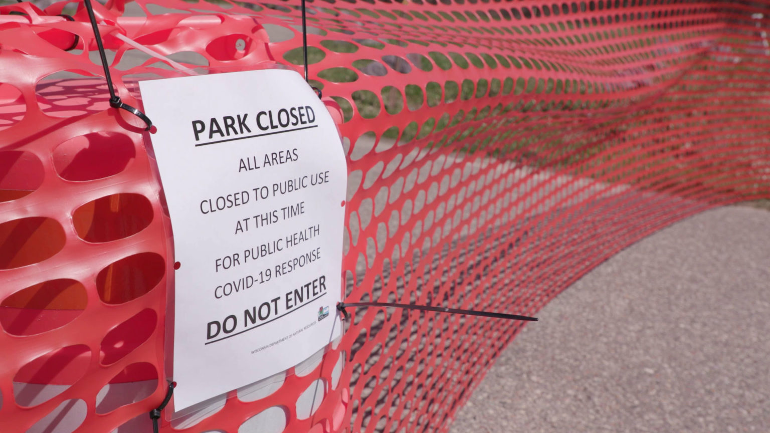 A sign showing state parks closed due to the COVID-19 outbreak April 10, 2020.