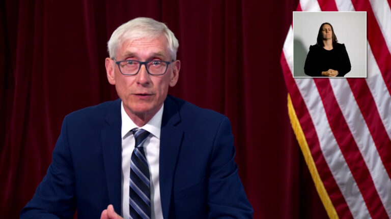 Gov. Tony Evers delivers a speech during a media briefing with the Department of Health Services.
