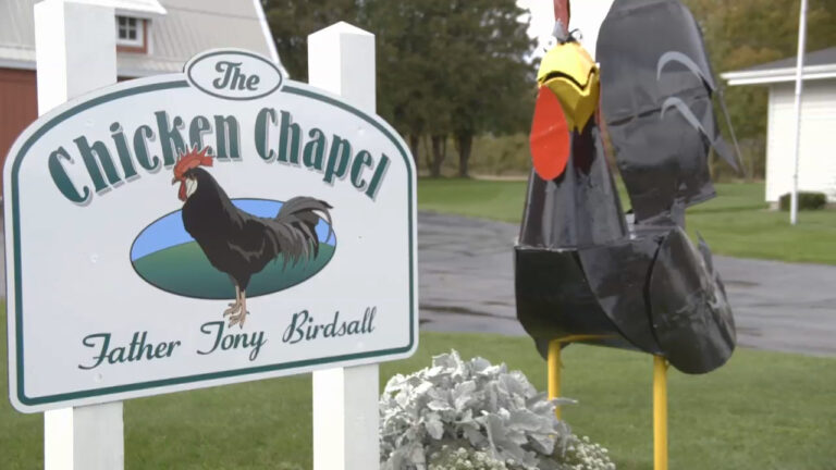 Sign that reads Chicken Chapel, Father Tony Birdsall