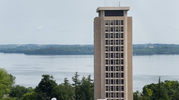 A profile of Van Hise Hall, home of the UW System administration, at the University of Wisconsin-Madison is pictured against a backdrop of Lake Mendota on June 10, 2010. (Courtesy: Jeff Miller / UW-Madison)