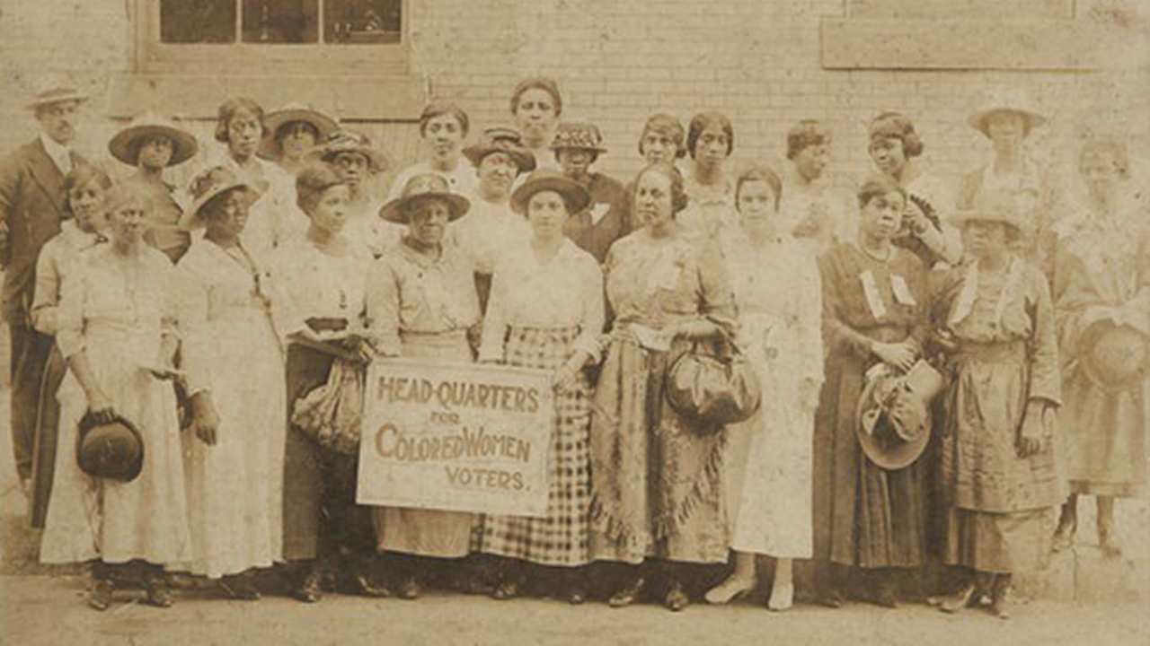 Black and White women suffragists post together in a group