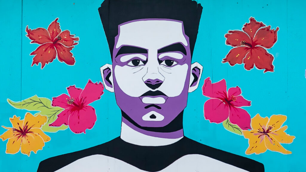Mural large-scale painting of a young Black man surrounded by flowers