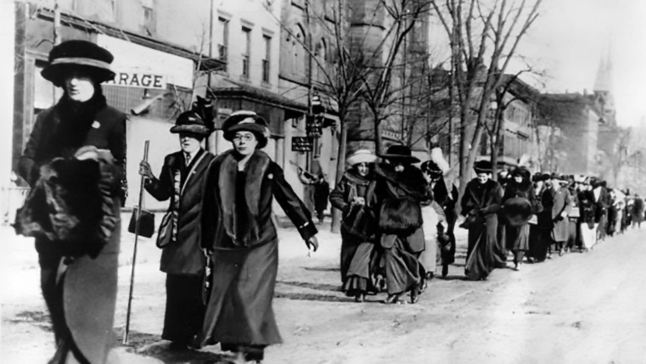 Suffragists march in a parade in the early 20th century