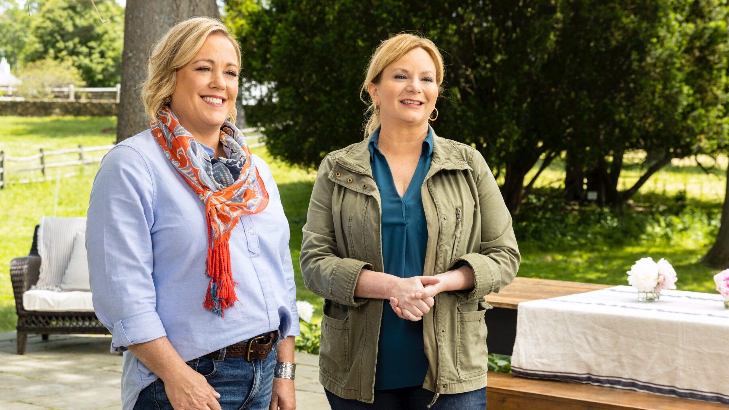 Cook's Country hosts Bridget Lancaster and Julia Collin Davison standing outdoors
