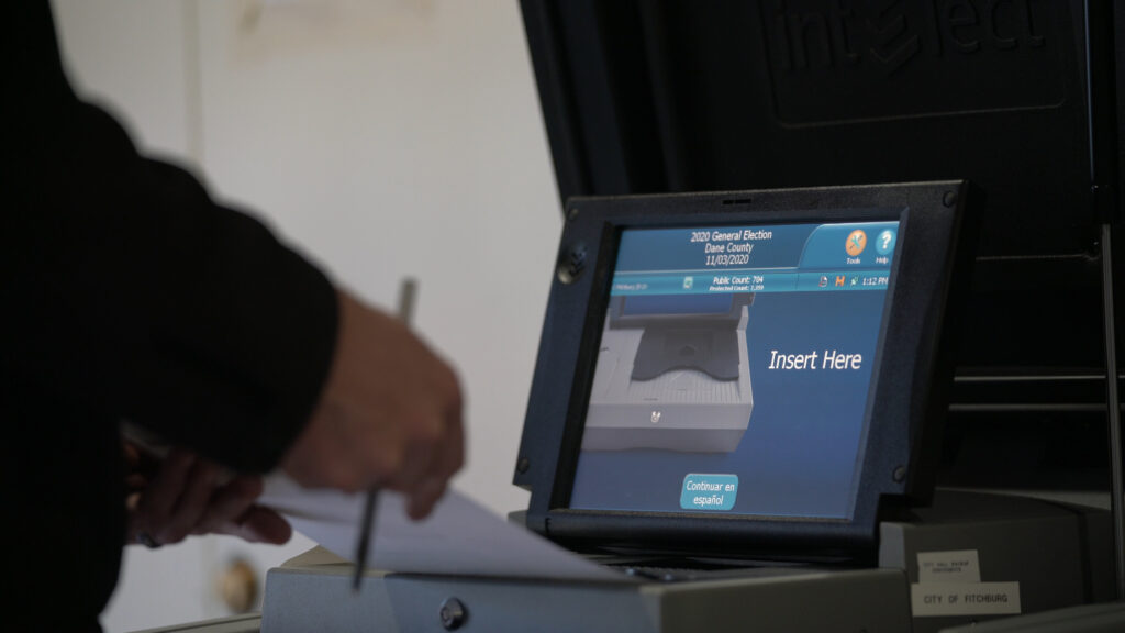 ballot inserted into machine