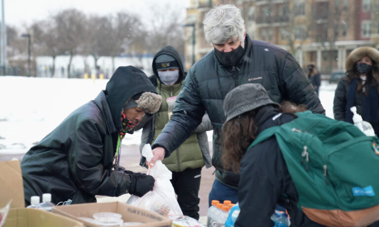 Volunteers sort food and clothing during a Justice for Jacob Blake, antifascist mutual aid action event at McPike Park in Madison.