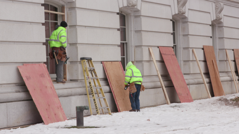 Workers board up Capitol
