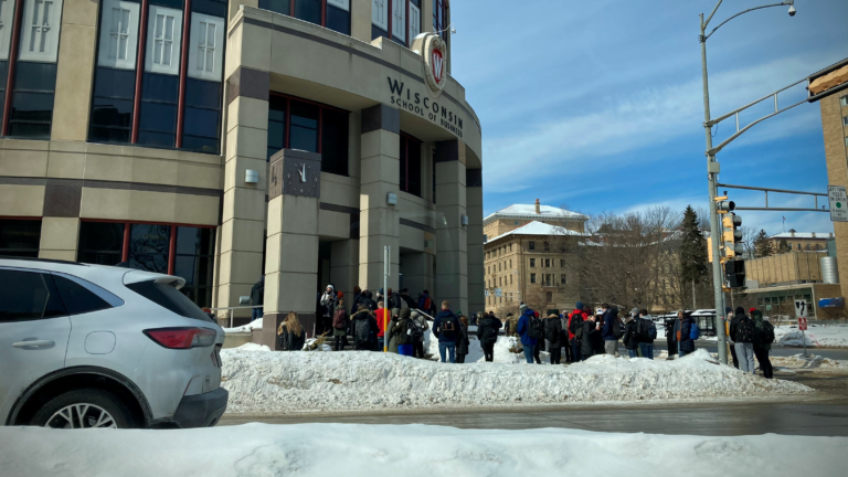 Students line up outside a UW-Madison building