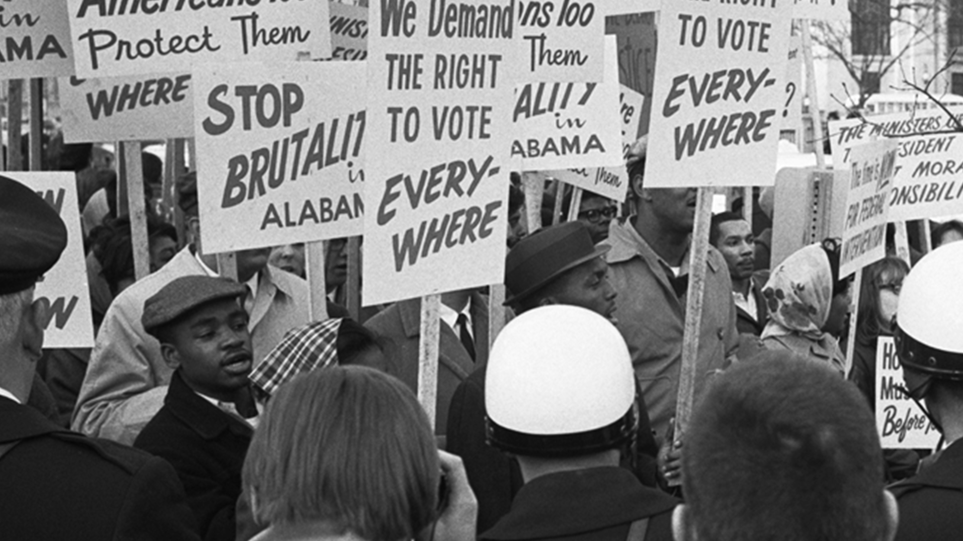 "From the Library of Congress Prints and Photographs Division. African American demonstrators outside the White House, with signs ""We demand the right to vote, everywhere"" and signs protesting police brutality against civil rights demonstrators in Selma, Alabama, 1965. Photo/Warren K. Leffler."