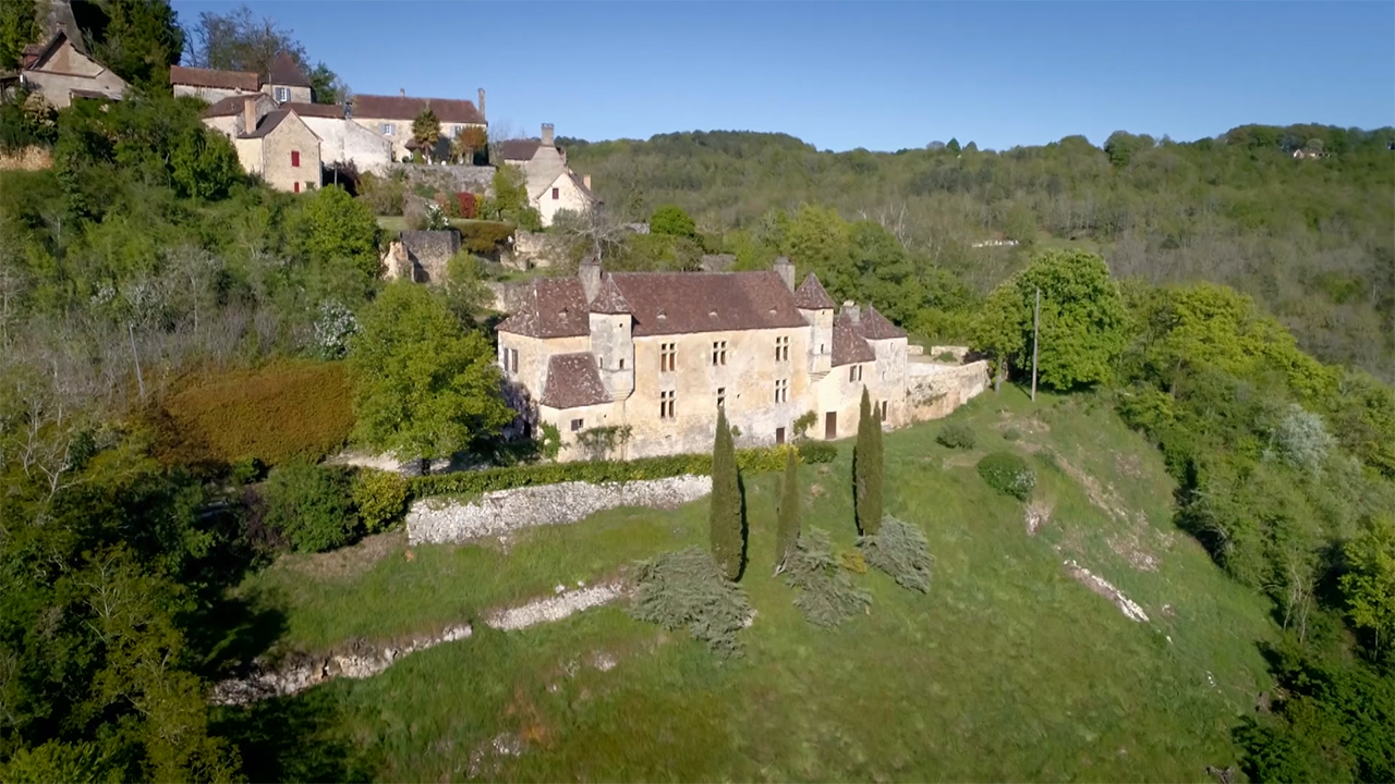 A chateau on a hillside in France