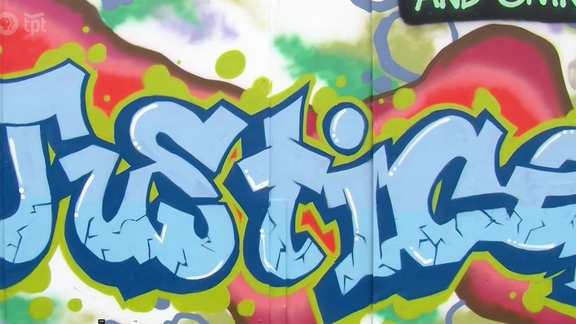 A colorful mural with the word Justice at its center