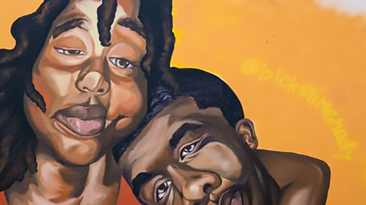 A mural depicting a Black woman cradling a Black man in her arms