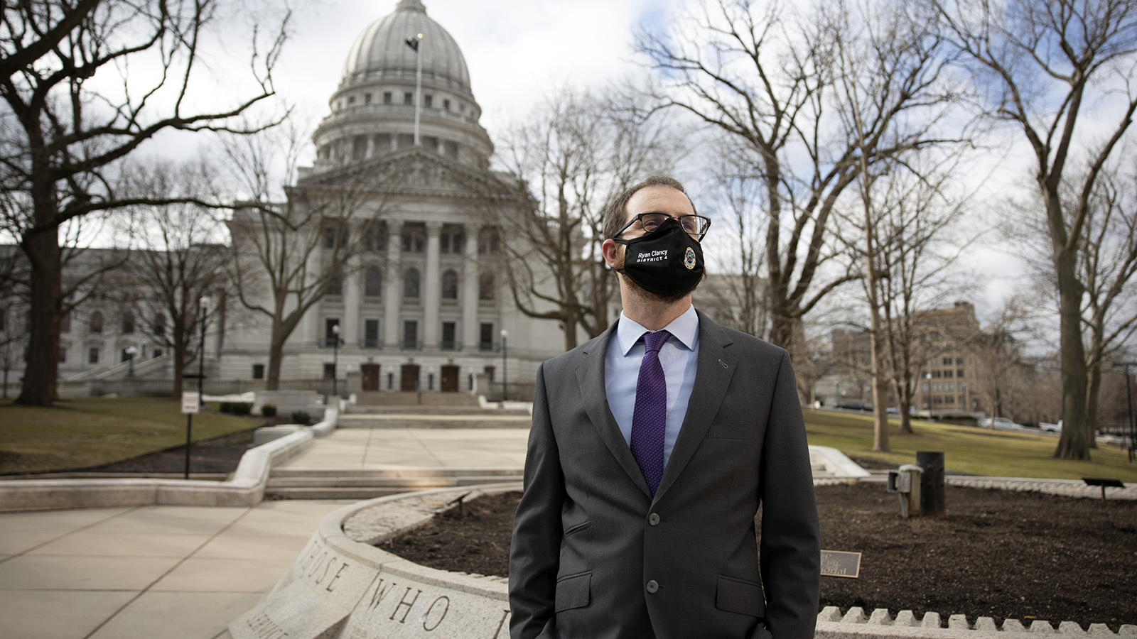 Portrait of Ryan Clancy in front of Wisconsin State Capitol