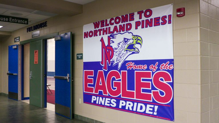 Northland Pines Home of the Eagles banner in high school hallway