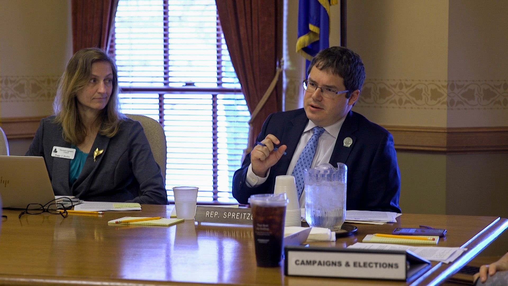 Rep. Mark Spreitzer speaks at a table at the Wisconsin Capitol