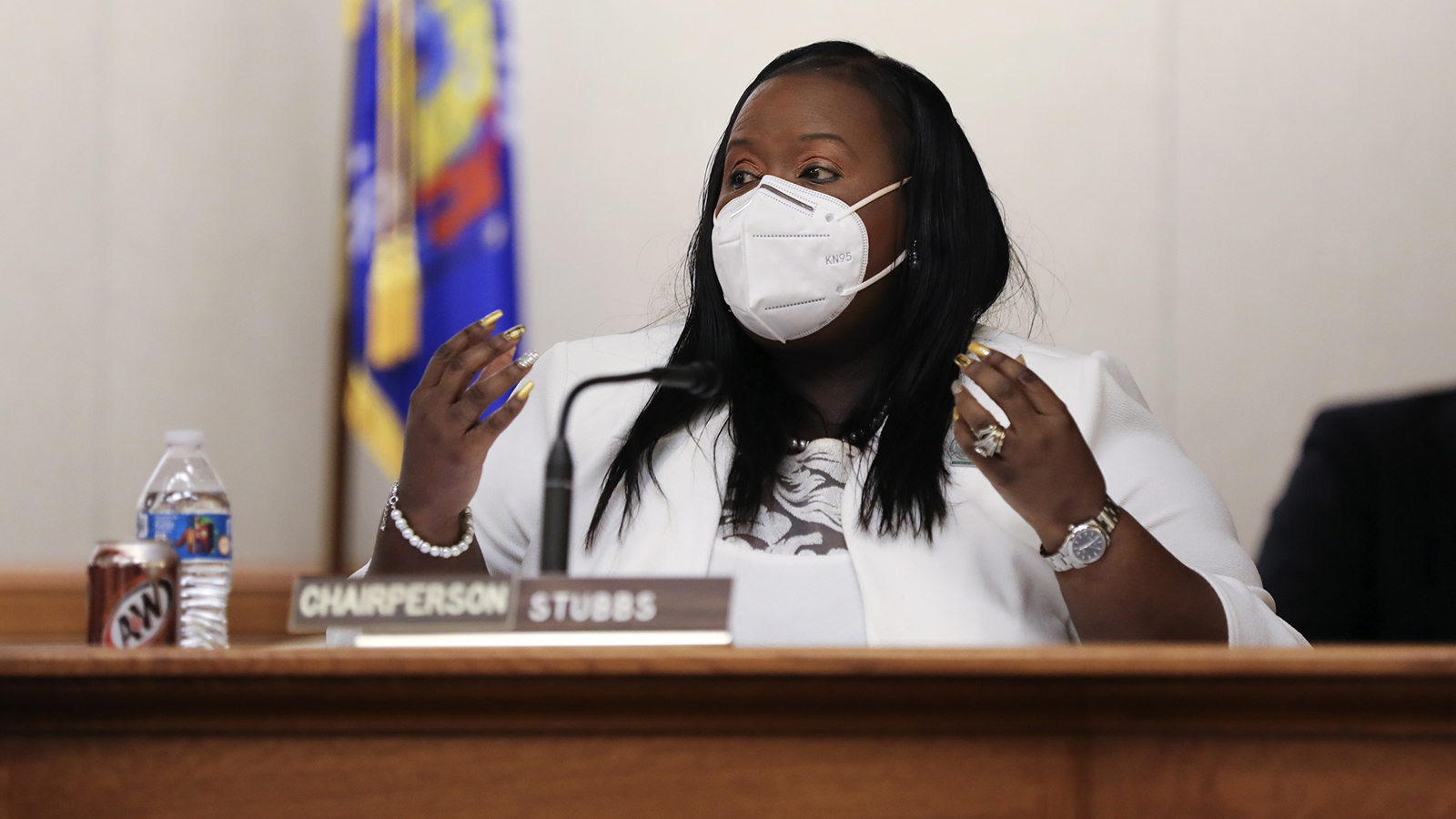 Shelia Stubbs wearing face mask at hearing table in Wisconsin Capitol