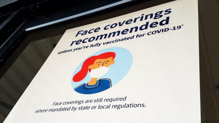 A window reads Face coverins recommended unless you're fully vaccinated for COVID-19 — Face coverings are still required where mandated by state or local regulations.