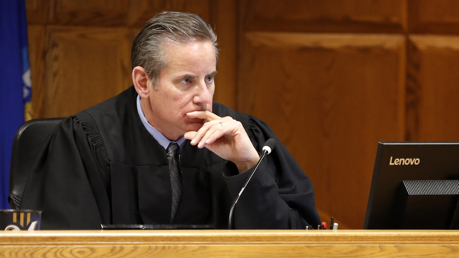 Outagamie County Circuit Judge Vincent Biskupic sits at a bench in a courtroom