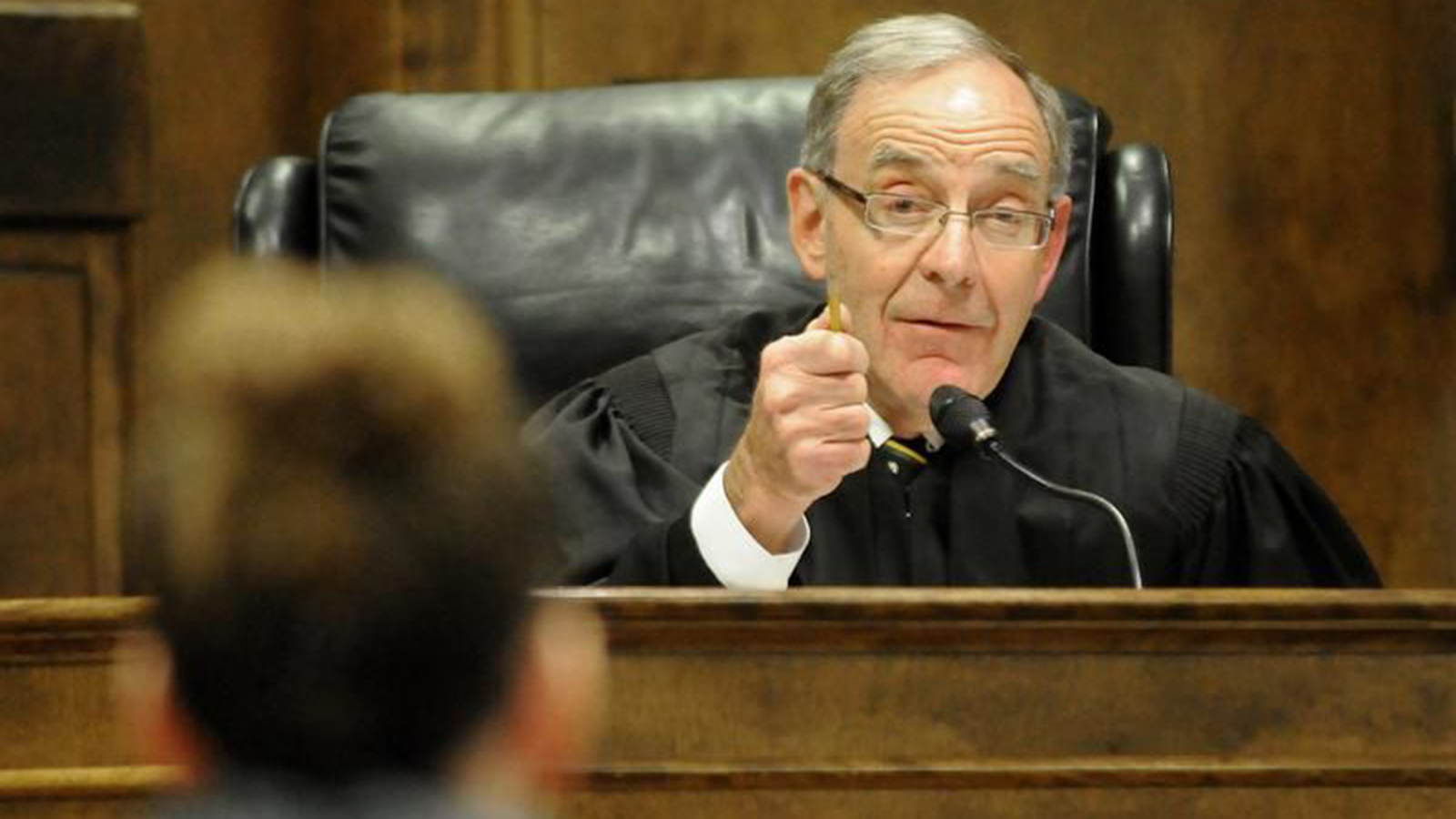 Brown County Circuit Judge Donald Zuidmulder speaks while sitting at the bench in a courtroom.