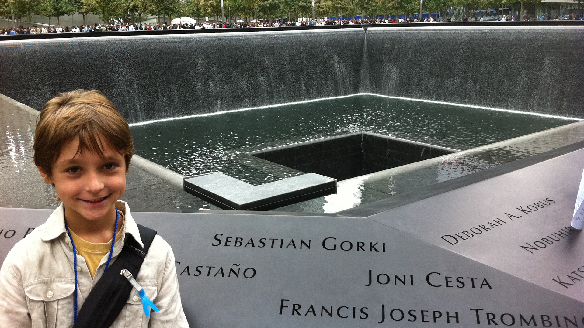A child stands in front of the Sept. 11 memorial pool in New York City.