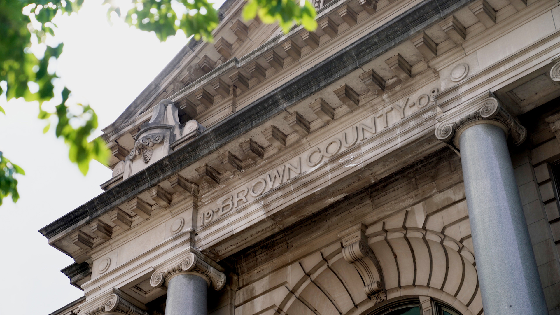"""Ornate courthouse frieze with """"Brown County"""" and """"1908"""" characters"""