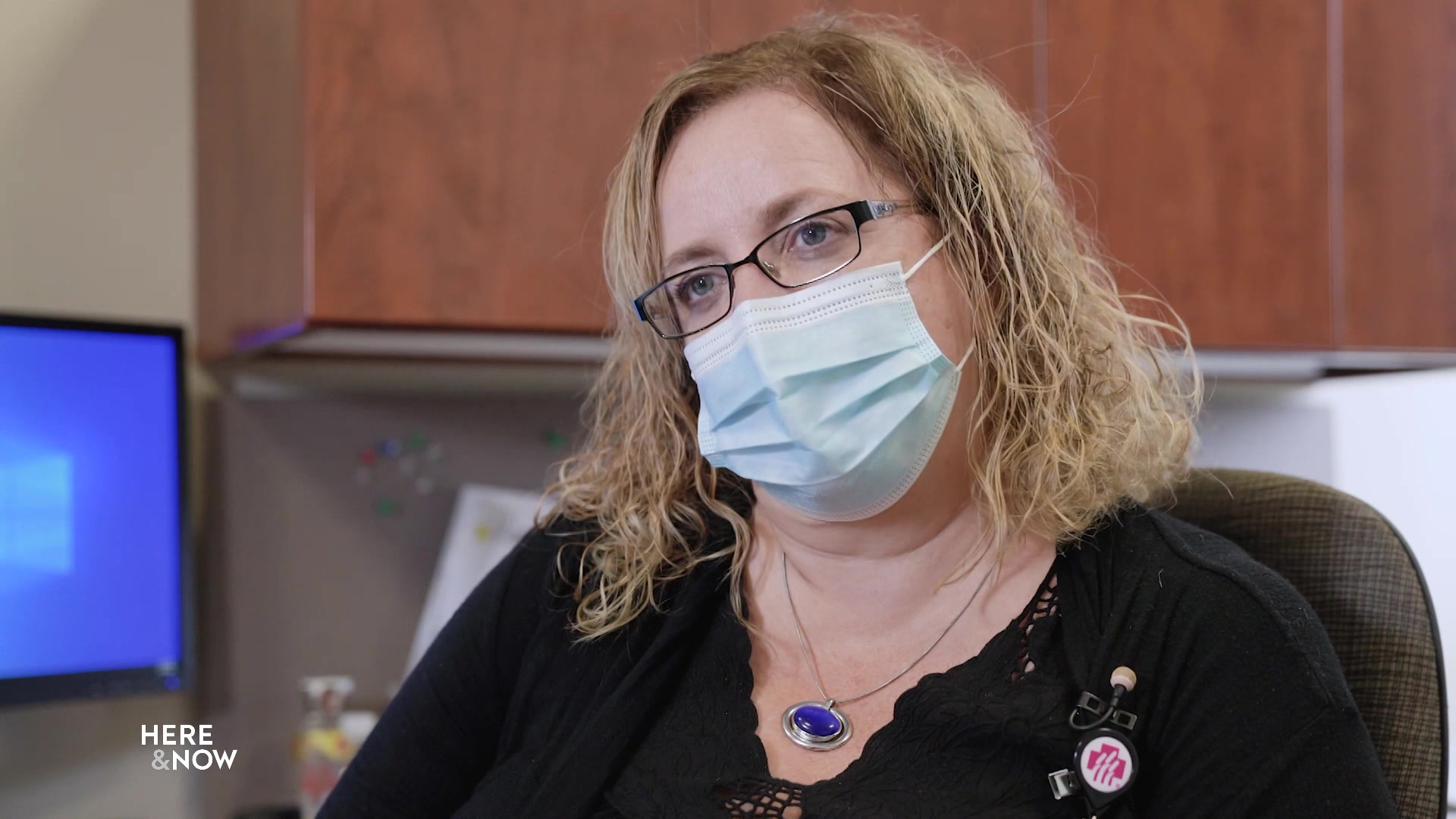 Vicky Varsho wears a mask while seated in an office.