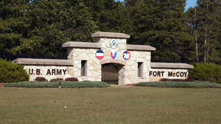 A stone gate marks the entrance to the U.S. Army installation Fort McCoy.