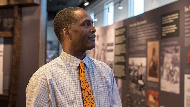 Reggie Jackson looks at a display at America's Black Holocaust Museum.