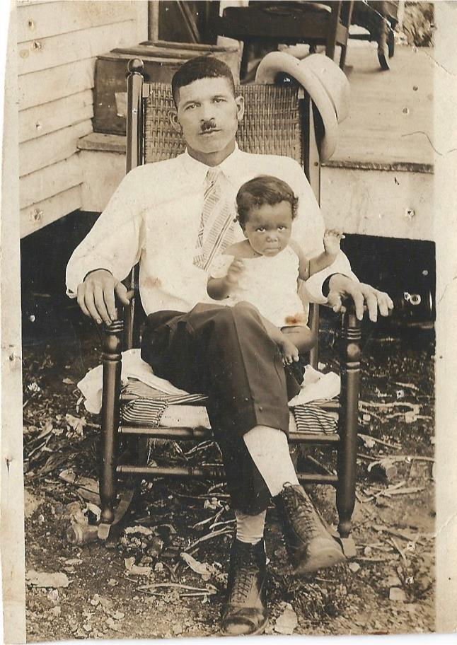 A black-and-whit photo dating from the 1920s of Sallie Diltz sitting on the lap of Ed Diltz.