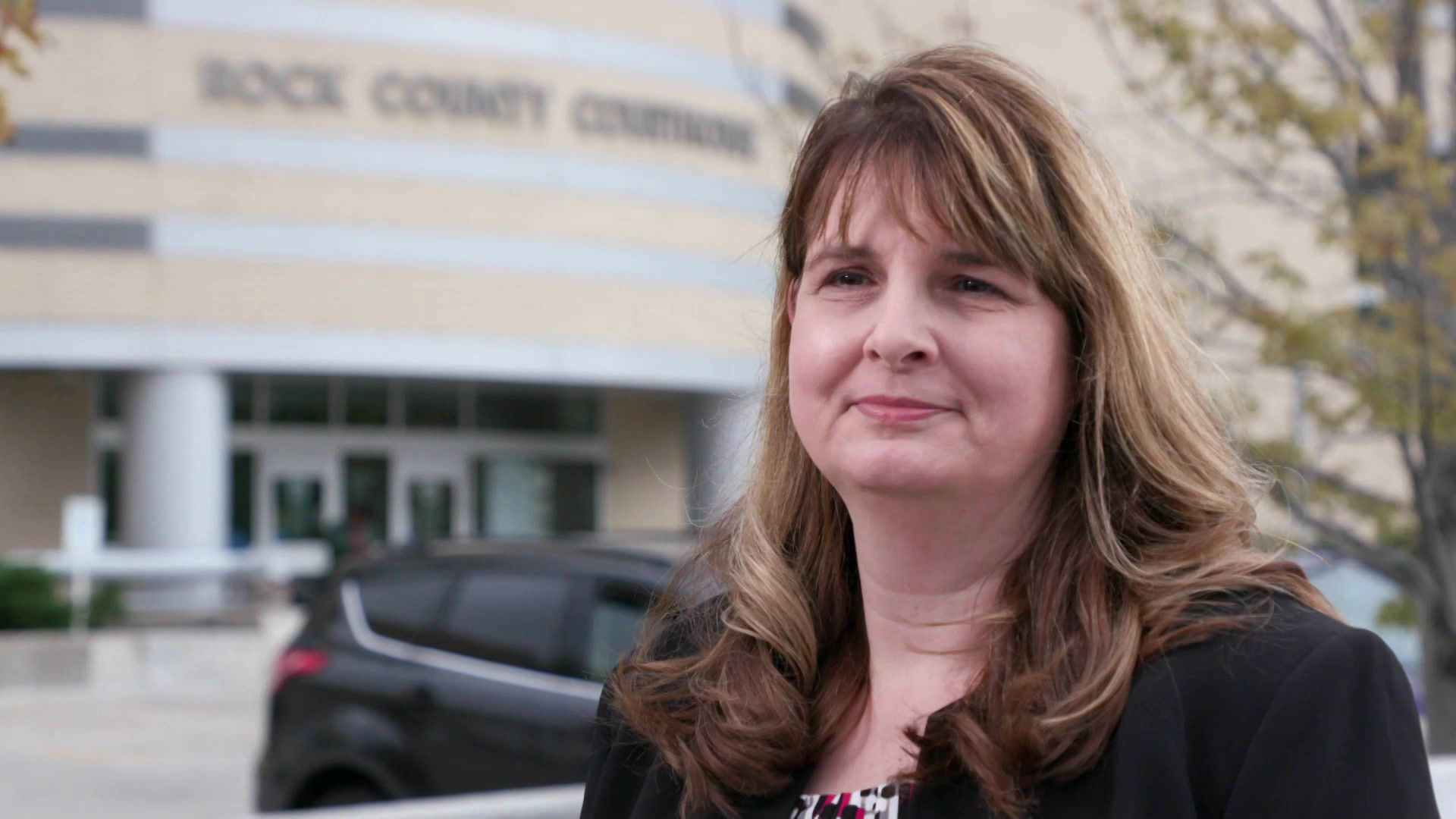 Lisa Tollefson stands in front of the Rock County Courthouse.