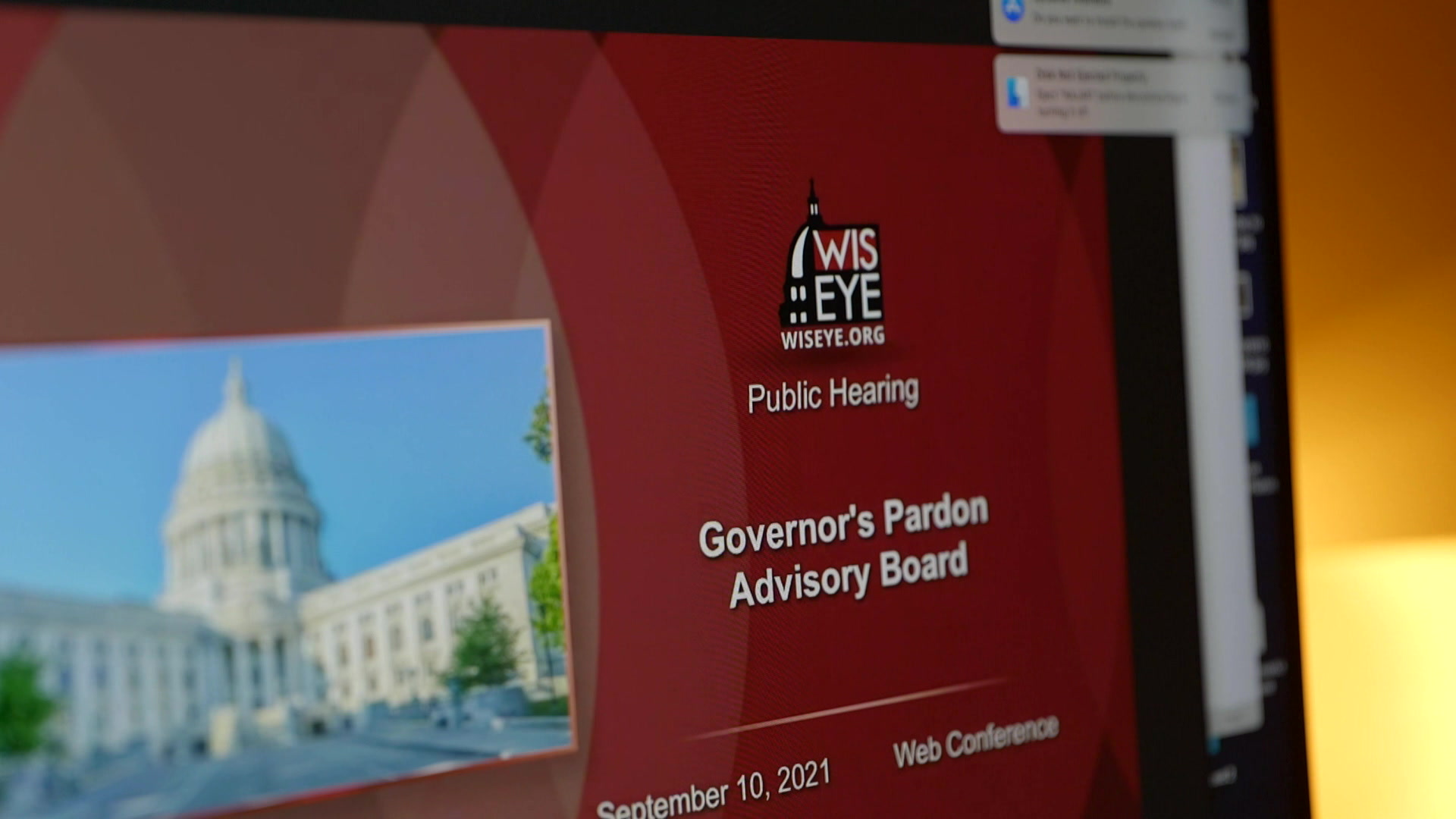 A compter shows the title screen for a WisEye presentation of a Governor's Pardon Advisory Board web conference.