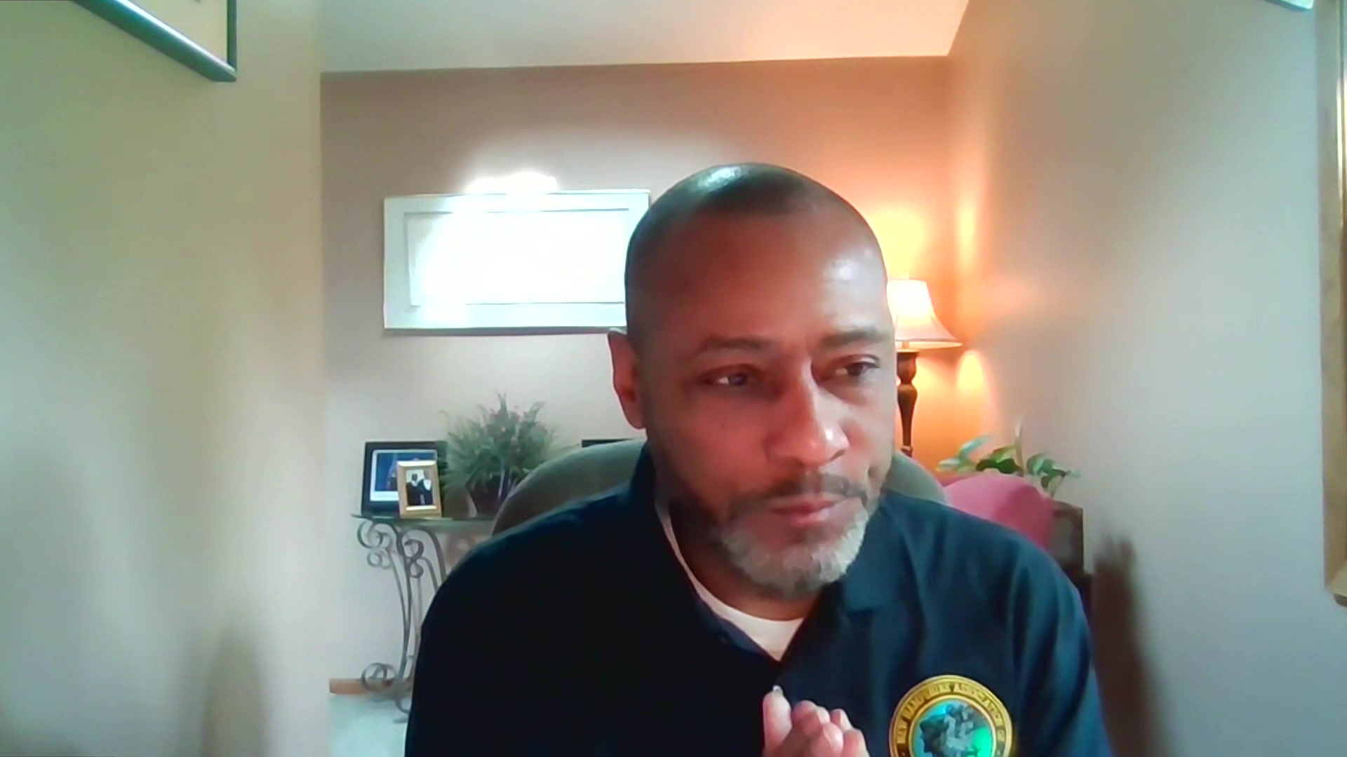 Noble Wray sits in a room while participating in a web conference interview.